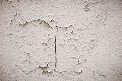 Gray cement wall with traces of the brush on the crumbling plaster. textural composition stock images
