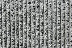 Gray cement wall with vertical lines. Closeup of rough, gray wall to reduce traffic noise made of cement with 17 vertical lines Stock Image