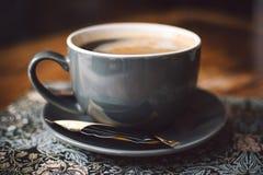 Gray Ceramic Cup of Coffee on Round Gray Saucer Stock Photos