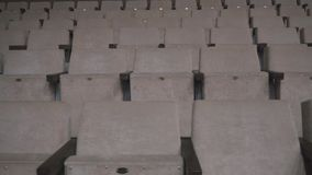Gray chairs in an empty cinema hall. Empty chairs. The failure of the film at the box office. Concert hall without spectators and fans. The night before the stock video