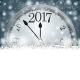Gray Christmas Card Cover Winter Snowflakes Clock 2017. Christmas card with snowflakes, clock and date 2017 on the gray background Stock Photos