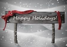 Gray Christmas Sign Happy Holidays, nieve, cinta roja, copos de nieve Fotografía de archivo