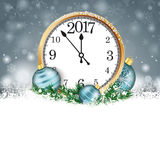 Gray Christmas Snowflakes Cyan Baubles Clock 2017. Christmas card with snowflakes, candles an cyan baubles on the gray background Royalty Free Stock Images