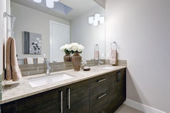 Gray and clean bathroom design in brand new home Stock Image