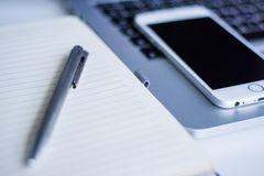 Gray Click Pen on White Notebook Beside Silver Iphone 6 Royalty Free Stock Photo
