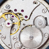 Gray clockwork of old mechanical watch. Watchmaker workshop - gray clockwork of old mechanical watch Royalty Free Stock Image