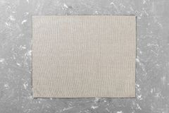 Gray cloth napkin on brown rustic wooden background top view with copy space.  stock photography