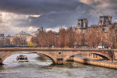 Gray clouds over Pont Louis-Philippe Stock Images