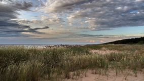 Clouds over sea coast Stock Image