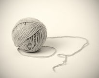 Gray clue of yarn on light background Stock Images