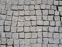 Gray cobblestone with black shadows Stock Photos