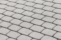 Gray cobblestone pavement texture Royalty Free Stock Image