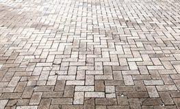 Gray cobblestone road pavement, texture Stock Photos