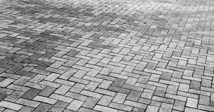 Gray cobblestone road pavement texture. Gray cobblestone road pavement, wide background photo texture Royalty Free Stock Images