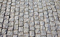 Gray cobblestone street close up Stock Photography
