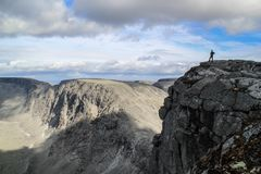 Gray, cold stone rocks in the majestic mountains of Russia. In the distance you can see the silhouette royalty free stock image