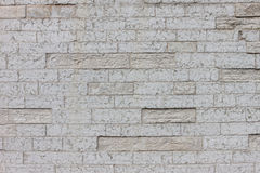 Gray color of design decorative cracked real stone wall surface Stock Images