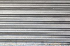 Gray color metal roller shutter door texture and background royalty free stock photo