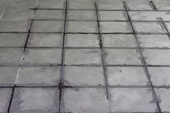 Gray color of new grout tile on tile gray. Gray color of new grout tile on tile gray for the final step for flooring in Thailand Royalty Free Stock Images