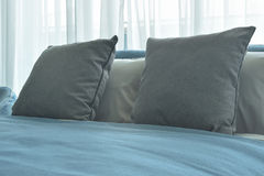 Gray color pillows on bed with blue blanket in modern bedroom interior. Gray color pillows on bed with blue blanket in modern bedroom Royalty Free Stock Image