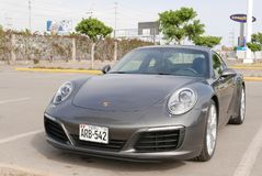 Gray color Porsche 911 Carrera parked in Lima. Lima, Peru. November 5, 2017. Front and side view of a gray color mint condition Porsche 911 Carrera built in Stock Image