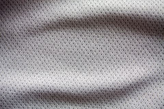 Gray color sports clothing fabric jersey. Closeup of gray color sports clothing fabric jersey Royalty Free Stock Photography