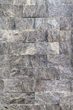 Gray color wall of natural stone. Background texture Stock Photos