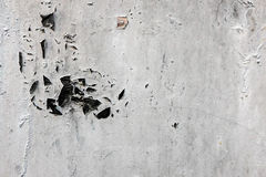 Gray colored disaggregable paint of a wall Royalty Free Stock Images