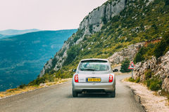 Gray colour Nissan Micra car on background of French mountain na Stock Photography