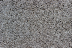 Gray concrete backgroundl with small stones Stock Images