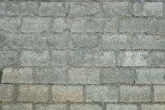 Gray concrete blocks wall, seamless background photo texture Stock Photos