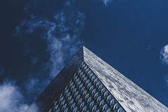 Gray Concrete Building Under Cloudy Sky Stock Image