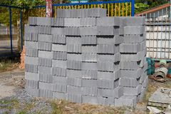 Gray Concrete Cinder block used for wall construction. Stack of Many Gray Concrete Cinder block used for wall construction. Located in the building materials stock photography