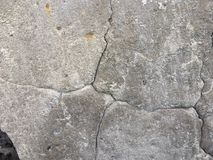 Gray concrete cracked wall, rural construction and architecture royalty free stock images