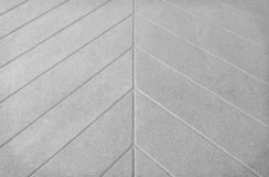 Gray concrete floor in line printed patterns texture on background. Close up Gray concrete floor in line printed patterns texture on background royalty free stock image