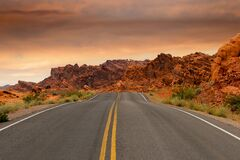 Gray Concrete Road Beside Brown Mountain during Golden Hour Royalty Free Stock Photos