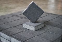 Gray Concrete road curbs at the factory warehouse. For the production of cement products, paving slabs. Industry manufacturing concept Royalty Free Stock Photography