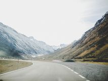 Gray Concrete Road Surrounded With Mountains stock images