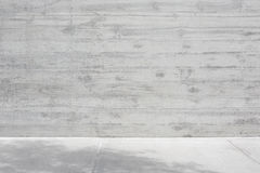 Gray concrete rough wall and empty floor royalty free stock photography
