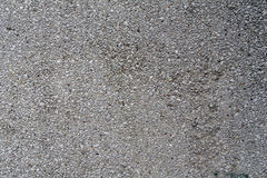 Gray concrete rough wall with protruding stones for texture or background Stock Photos