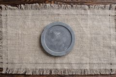 Gray concrete round signboard on light fabric and wooden brown background stock photos