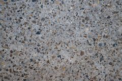 Gray concrete surface. With inclusions of stones Royalty Free Stock Image
