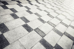 Gray concrete tiling with abstract pattern, urban pavement Stock Images