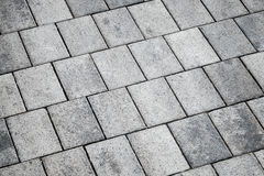 Gray concrete tiling pavement, background texture Stock Images