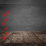 Gray concrete wall with red hearts Royalty Free Stock Photography