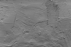 Gray concrete wall with rough plastering relief. Pattern, flat photo background texture Stock Photos