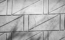 Gray concrete wall texture with diagonal black relief lines royalty free stock photo