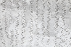 Gray concrete wall texture with notching pattern Stock Image