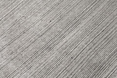 Gray concrete wall texture with relief lines Royalty Free Stock Photos