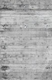 Gray concrete wall with wood relief pattern Royalty Free Stock Photography
